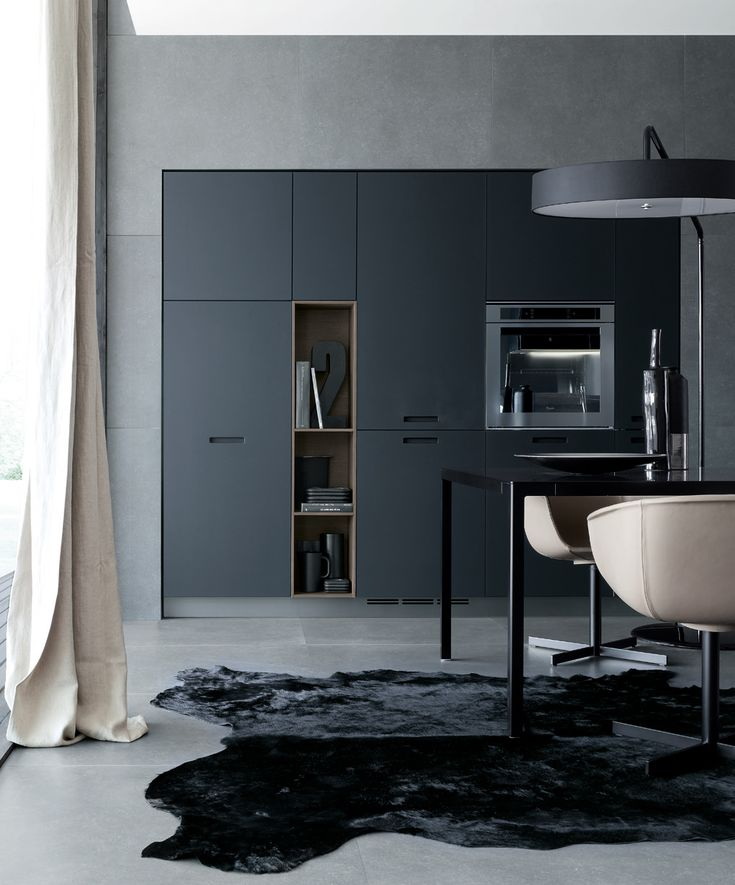 Kyton in siena oak and frosted glass nero, worktop in stainless steel with double thickness 12 and 142 mm.