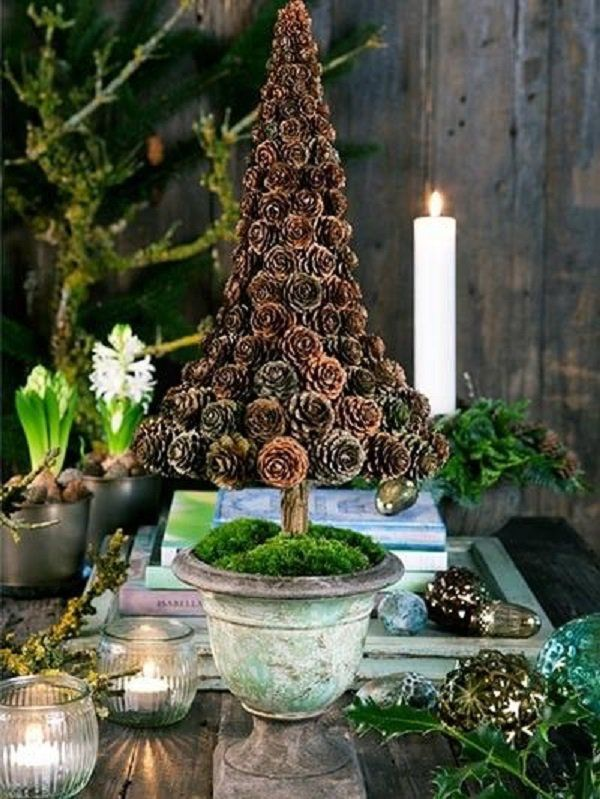 Pinecone inspired Christmas tree. Go out of your way to be creative and collect pinecones to form your very own mini Christmas tree on a vase.