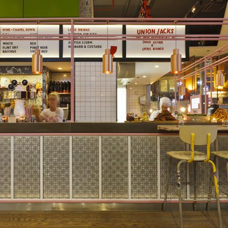London studio Blacksheep have completed a pizzeria for celebrity chef Jamie Oliver where a cinema listings board displays the menu and diners can watch chefs at work on vintage televisions. They use peg boards too!