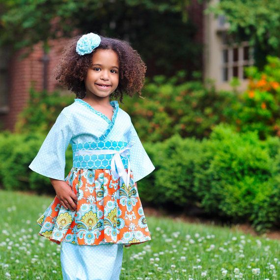 This gorgeous little outfit is perfect for birthdays, school and parties!  The boutique kimono top and pantaloons/bloomers are made in prints of orange and turquoise finished with a obi sash.      The fabulous handmade boutique set is available in sizes 2T to 7 years.    Choose from three sleeves length - short, long or 3/4 (shown)     -Handmade Clothing Outfit in sizes 2T to 7 years old  -Includes top, pantaloons and obi belt  -Available in choice of 3 sleeve lengths  -Designer cotton…