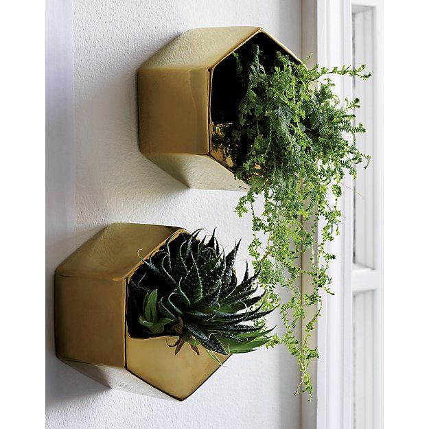 Shop bolt gold wall vase.   Angled stoneware floats your favorite greens at unexpected heights.  Shiny gold shape makes a statement in multiples.  Suspend from the wall for freestand.  Perfect for airplants.