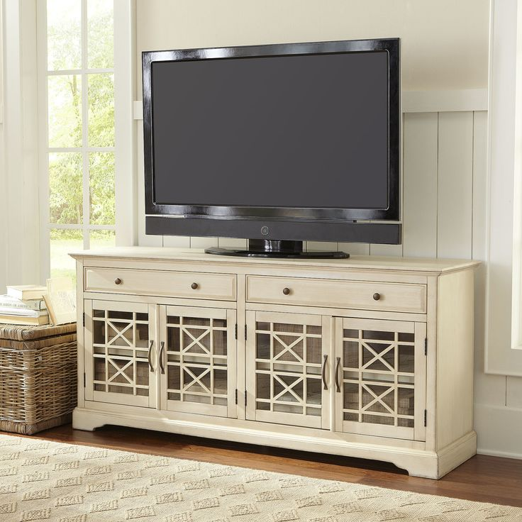 Hubert Media Stand | The distressed finish of the Hubert Media Stand evokes the comfort of a weathered keepsake. Two pull-out drawers and four detailed doors provide ample and stylish storage.