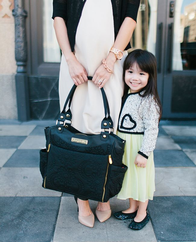 Stylish black diaper bag with gold hardware! Love! By @Petunia Pickle Bottom | little peanut magazine