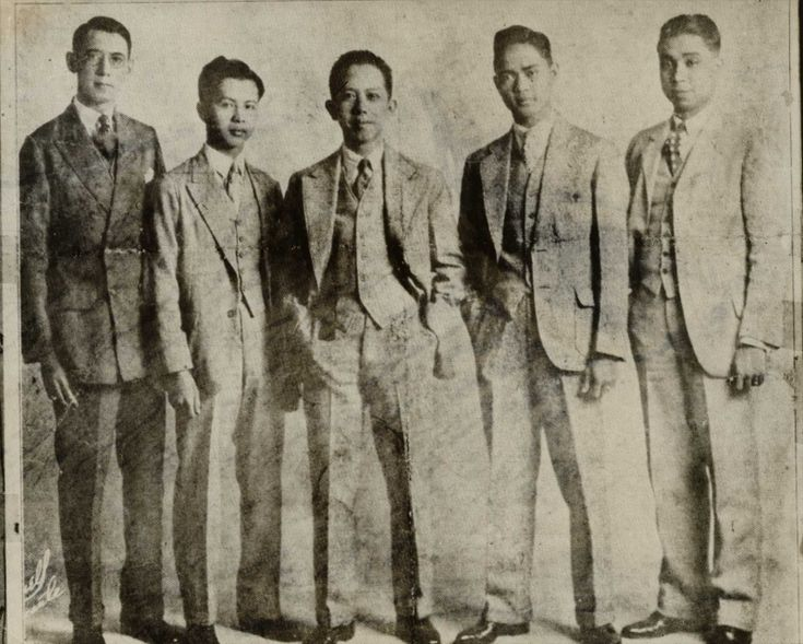 "Team members of the University of the Philippines debate team, with Professor Carlos P. Romulo (center). From left: Pedro Camus, Teodoro Evangelista, Deogracias Puyat, and Jacinto C. Borja. The photo was taken in San Francisco, California, April 18, 1928, and the caption reads: ""Four students of the University of the Philippines, under the leadership of Prof. Carlos P. Romulo of the College Faculty, recently arrived in the United States on a tour of the world to debate the question of…"