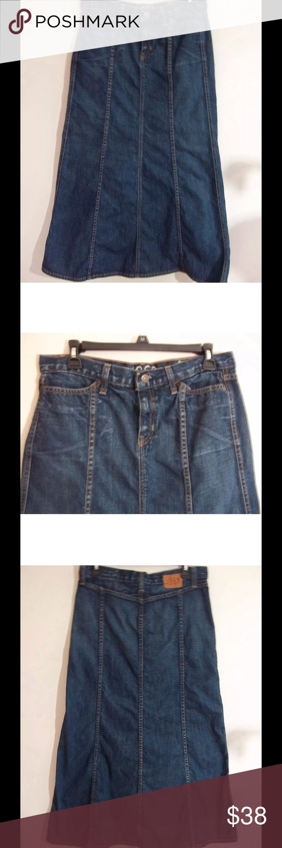 Gap Women's Denim Jean Skirt Long Modest Sz 6 GAP Women's Jean Skirt Long Denim Size 6 Modest Blue Seamed Distressed Zip Front  Brand: Gap Color: Blue  Size: 6 Style: Long modest denim jean skirt Material: 100% Cotton Condition: Very gently used. No rips, holes, tears or stains.  Made: USA Length: Long-37 1/2 inches from waist to hem Waist: 33 inches  Additional features: Zip front with button closure. 2 front pockets. Gap 1969 label on back. Belt loops. Seamed down front and back of jean…