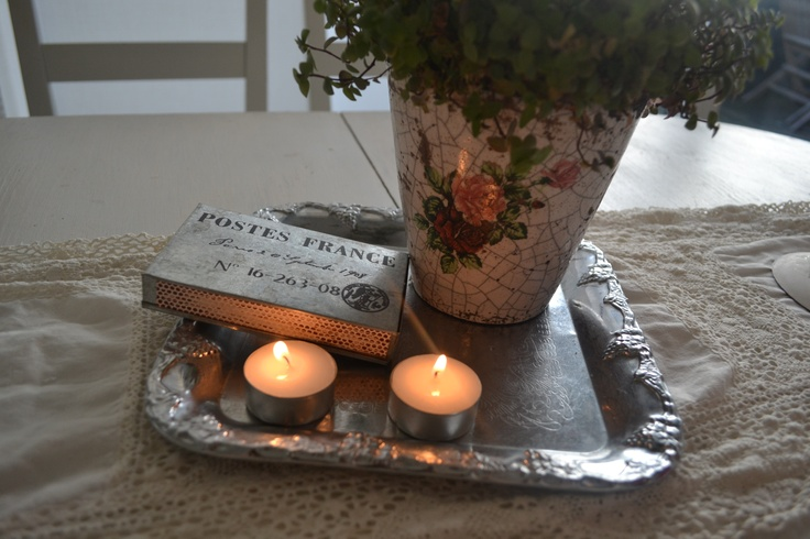 Flower, lights and a french matchbox.