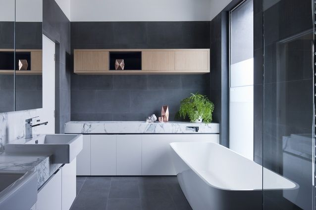 Basalt tiles and Calacatta marble feature in the bathroom.