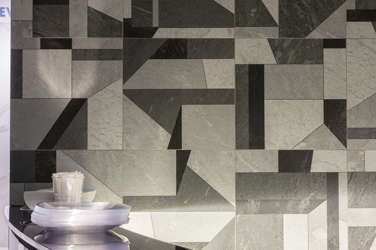Geometric shapes of the Tangram decor from iNNER stone-effect porcelain collection enrich the living room or kitchen areas #Cersaie #bathroom #finishing #surfaces #design #ceramic #floor #wall #tiles #stoneware #interior #design #architecture #arredo #superfici #ceramica #mattonelle #piastrelle #arredamento #pavimenti #rivestimenti #cucina #kitchen #livingroom #living #tangram #grey #greyscale #black #white #decors
