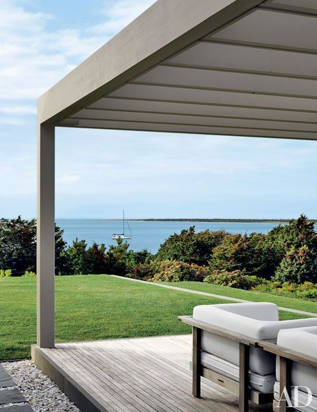 A pergola frames views out to the water