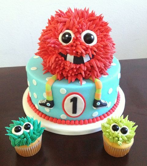 Red Monster Cake! - Red Monster Cake with matching monster cupcakes.  Monster eyes are black gum balls.  Cake is marshmallow fondant and monster hair is buttercream.