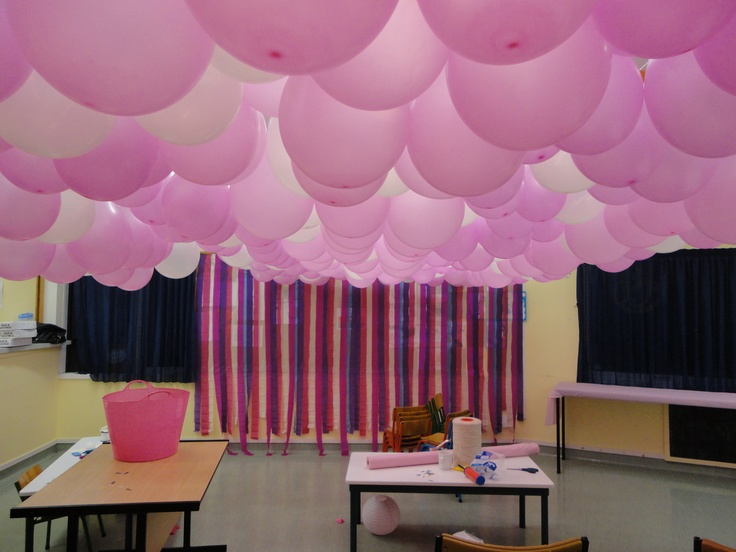 Using multiple coloured pink, and other crepe paper you have spare, create a backdrop for your main table that is eye-catching, and effective.