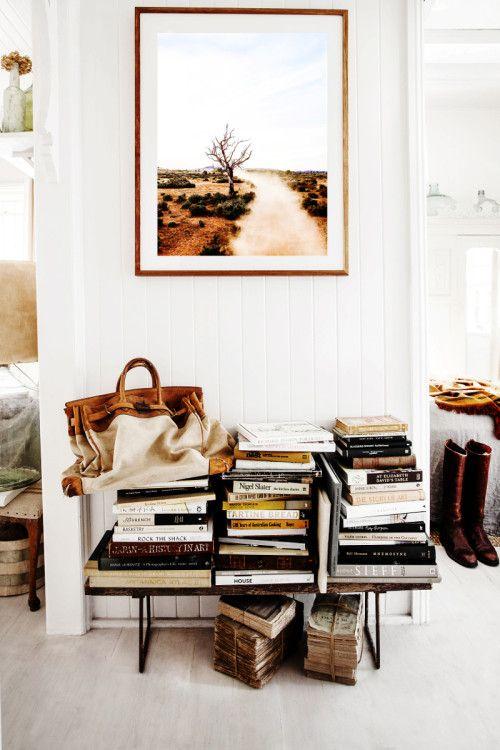 Art books on bed head