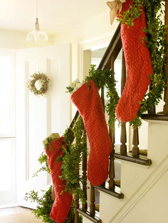No fireplace? Hang stockings and garland from the stair railing. More Christmas