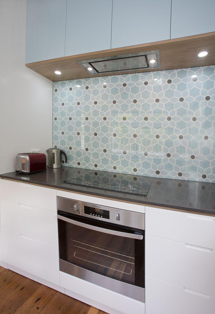 "Sally Steer Design Ltd. Wellington New Zealand. Caesarstone benchtop ""Raven"". Feature wallpaper behind glass splashback (backsplash)."