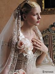 I like the way the veil is attached at the base of the bun...