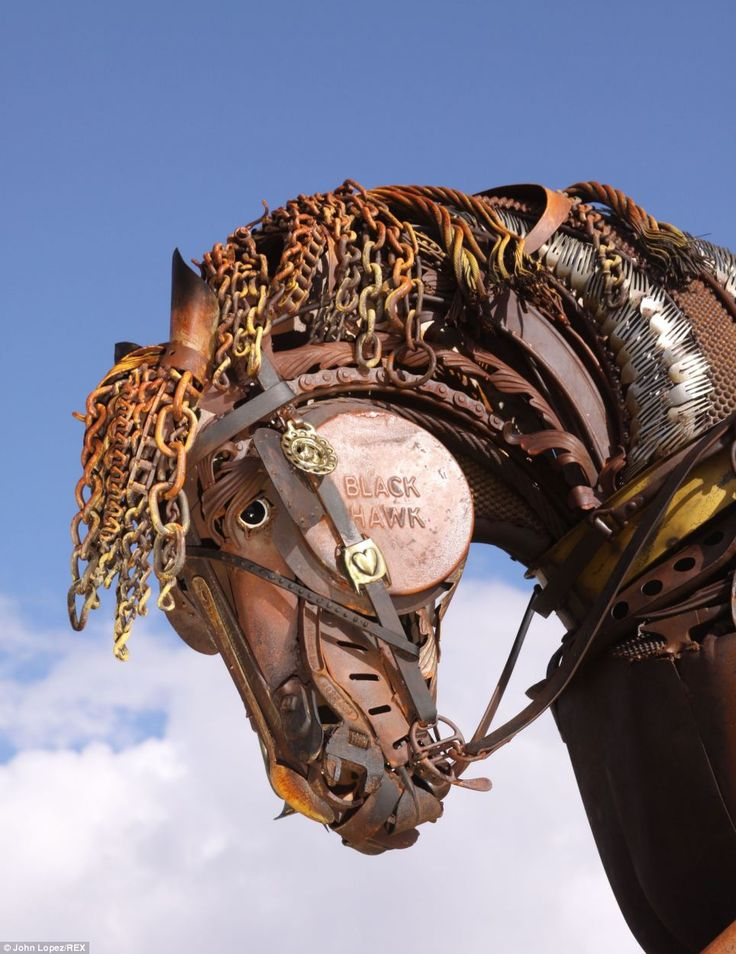 Black Hawk is a scrap iron sculpture of a life-size plow horse pulling a single bottom plo...