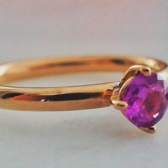 A beautiful pink sapphire set on 14-karat gold  #NANGI #beNANGI #finejewelry #jewelry #sapphire #gold #ring #pinksapphire