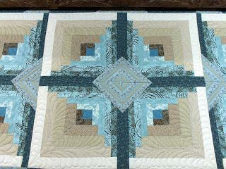 Curved Log Cabin, love the colours, and the quilting.