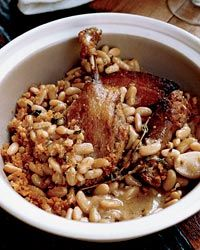 Cassoulet with Duck Confit - Chef Laurence Jossel created this stripped-down version of the classic French stew, with creamy white beans, luscious store-bought duck confit, smoky French garlic sausage and slab bacon. Letting the beans rest overnight develops their flavors.