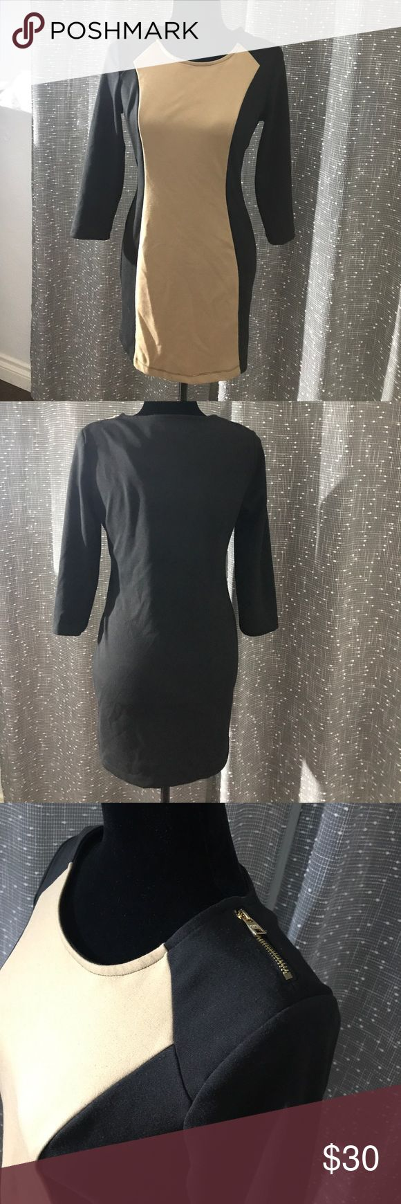 """MARC NEW YORK BLACK/CAMEL COLOR DRESS Good condition some of the seam came of it is shown on the pictures but other then that it's good.  Measurements  Shoulders 15"""" Chest 18"""" Length from shoulders to bottom is 31 1/2"""" Great for a night out or a holiday party. Andrew Marc Dresses Long Sleeve"""
