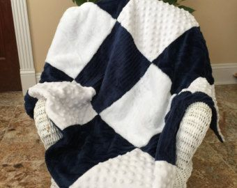 This patchwork minky blanket is the softest, most cuddly baby blanket your little girl will ever snuggle up with! It is thick, light and fluffy all in one. This minky blanket is a double sided blanket that features 5 different textures of minky fabric. The front side features patchwork of coral and cream and the reverse side is solid coral. Let your child play and explore while building their sensory skills by exposing them to different textures of fabric. Blanket measures approximately 29 x…