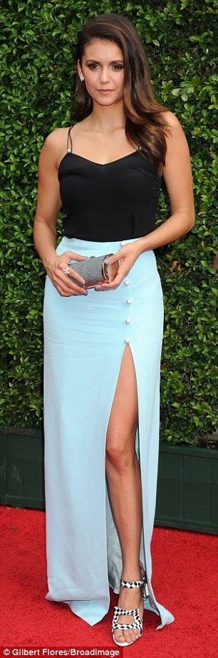 Top form: The 26-year-old was keen to impress with her vibrant black-and-white footwear