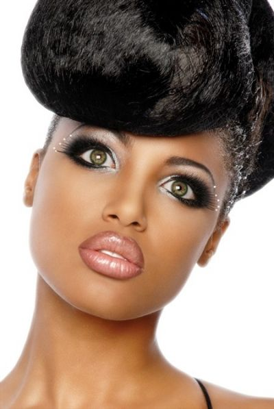 Gorgeous extra voluminous updo and beautiful makeup for African American women