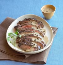 Steak au poivre—a classic French steak recipe that features a perfectly cooked steak crusted with cracked peppercorns and served with a rich, creamy sauce flavored with cognac or brandy.