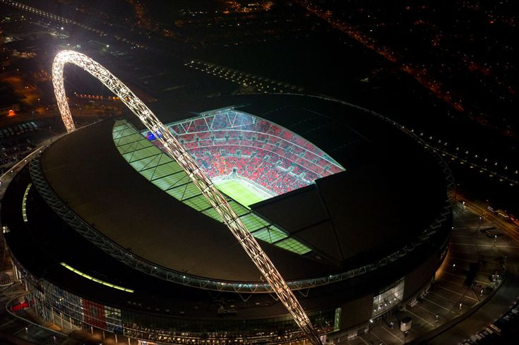 Wembley Stadium glows during a football match  Picture: Jason Hawkes / Barcroft Media