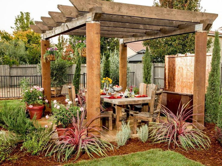 Pergolas are great for filtering sunlight while still giving you the feeling of being outside. If you're lucky enough to have one of these structures in your backyard, position the dining table under it and invite guests to sit a spell.