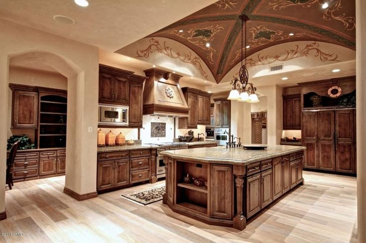Mediterranean Kitchen with Hardwood floors, Pendant Light, Limestone Tile, Complex granite counters, L-shaped, Flush