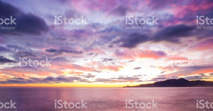 cloudy and purple sunset on the sea with Portofino mount foto stock royalty-free