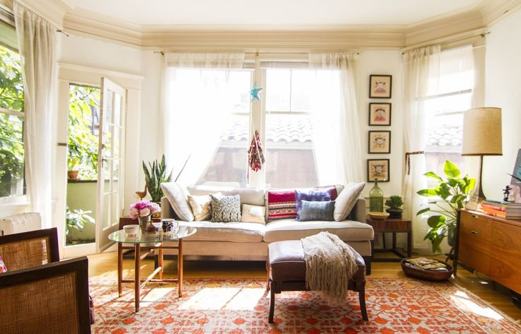 Rena's Global Eclectic San Francisco Apartment  White walls but still feels warm...and who says you need to center the coffee table with the sofa?