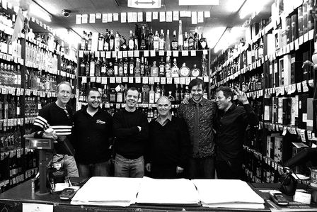 Michael Kyprianou and staff at Gerry's drink store in Old Compton Street. Michael came to London from Cyprus in 1960 and started out working at Delmonico's Old Compton Street wine and spirits store.