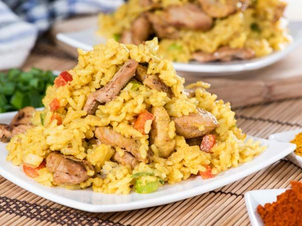 JADOH - This exciting dish  is a luscious pork and rice-based Khasi delicacy. Prepared in minimum oil, it has a unique and aromatic taste. No ceremony is complete without this sumptuous dish. Meghalaya, India