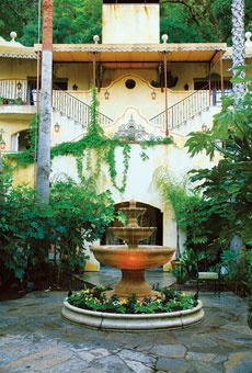 """Kenwood Inn and Spa in Kenwood, California. The Kenwood Inn, a 29-room resort set in the romantically named """"Valley of the Moon,"""" combines the best of these elements. The inn, designed like a Mediterranean villa, includes a swimming pool, sunning terraces, a steam room, a hot tub, a wine bar, and a dining room. The chef makes good use of local produce, cheeses, wines, and meats in a dining room with a fireplace and a courtyard. Rooms are plush, with fireplaces, feather beds, and cozy…"""