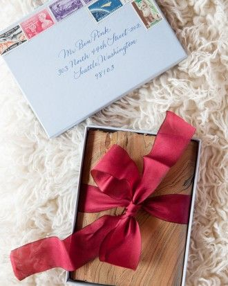 """This bride assembled invitation """"packages"""" in letterboxes accented with marbled paper and red ribbon. See more of Hanna and Jimm's Outdoor Fall Wedding in the Hudson Valley on our website!"""