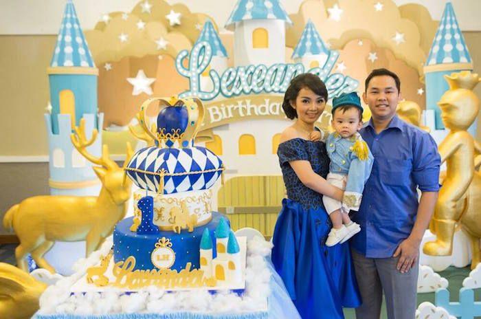 Cake + Birthday Boy + Parents from a Royal Prince 1st Birthday Party via Kara's Party Ideas | KarasPartyIdeas.com (6)