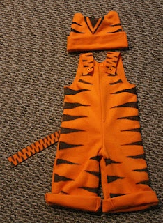 HUGE WIN  DIY Tiger! Made it this Halloween for my 3 year old son. It was very easy to make and just used a Sharpie for the stripes oh and had a friend who knows how to use a sewing machine :) If you know how to use one you are set! I went to Len's Mills for the fleece and just used a black hoodie and sewed ears on! Total spend $15 (fabric/buttons)