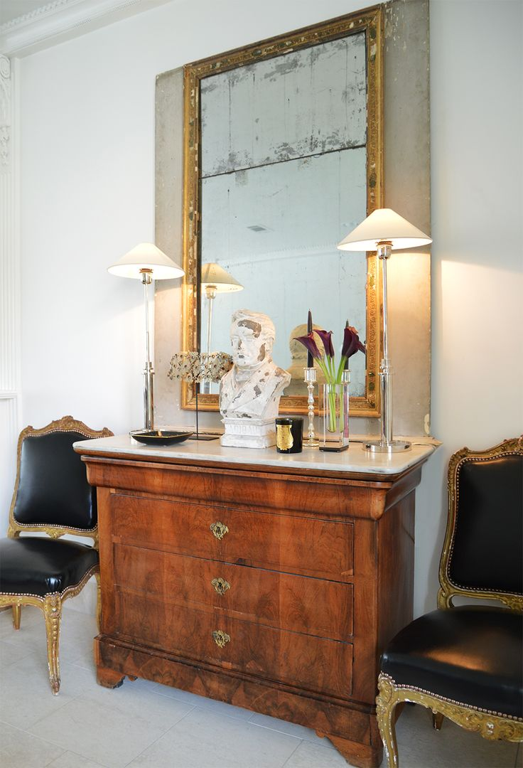 A glimpse inside of my home…a few things that I love: gilded antique chairs dressed in something modern {fabric from Dedar Milano}, the simplicity of J Randall Powers Interior Decoration Hargett Buffet Lamps, an antique bust that I found at Gerrie Bremermann fabulous Nola antique store AND always an AVF accent along side a Cire Trudon candle to fill my home with the scent of Trianon.