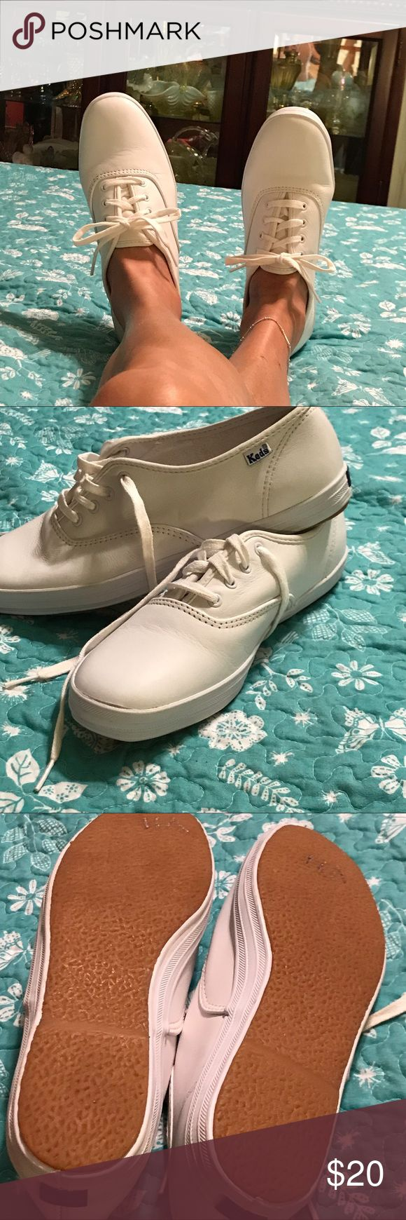 ladies white leather ked tennis shoes excellent condition ladies white leather kid tennis shoes size 7 1/2 superb condition hardly worn if you have any questions please ask I do except offers thank you for looking and happy poshing Keds Shoes Sneakers