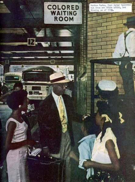 African American professor E.J. Thornton entering a Colored Waiting Room at a bus station   Location:Mobil, AL, US  Date taken:1956  Photographer:Gordon Parks