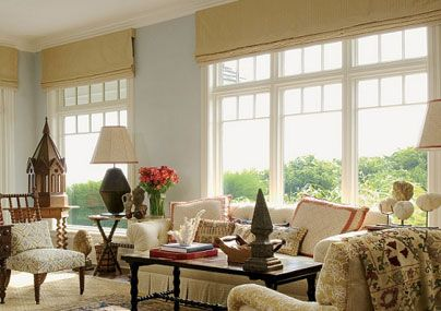 Installing roman shade above the window to make it appear for Hamptons style window treatments