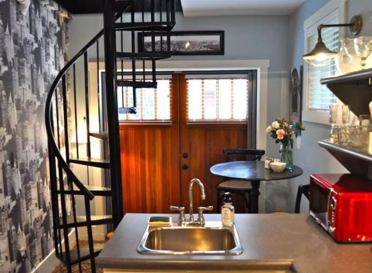Best The Spiral Stairs From Upstairs Lead To The Kitchen With 640 x 480