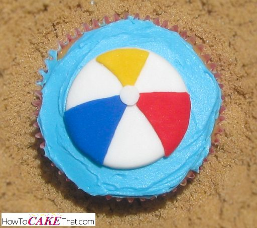 Summer beach ball cupcake topper! Easy to follow photo tutorial showing how to make this super cute fondant topper!