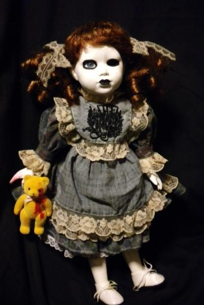 I finally did my own doll! I took one eye out and gave her a little doll.