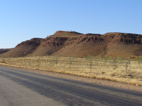 Greenstones and the Fortescue Group.  This is one of the world's best examples of an 'unconformity'. The surface of the unconformity represents the surface of the Earth 2 800 000 000 years ago. Pilbara, WA.