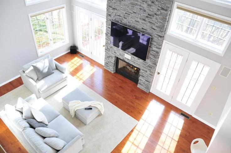 Cinnamon Maple is a Casa de Colour floor. I think this customer has my dream home - hardwood floors, floor-to-ceiling windows, stone fireplace - amazing! #5thWaLL #LumberLiquidators