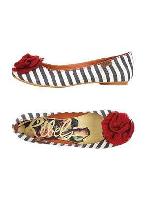 Navy and white striped flats with red rosette.