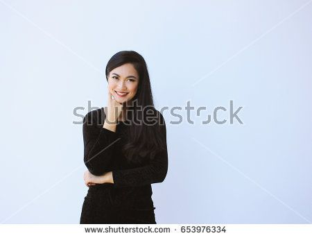 Successful asian business woman smiling and look confident on white background